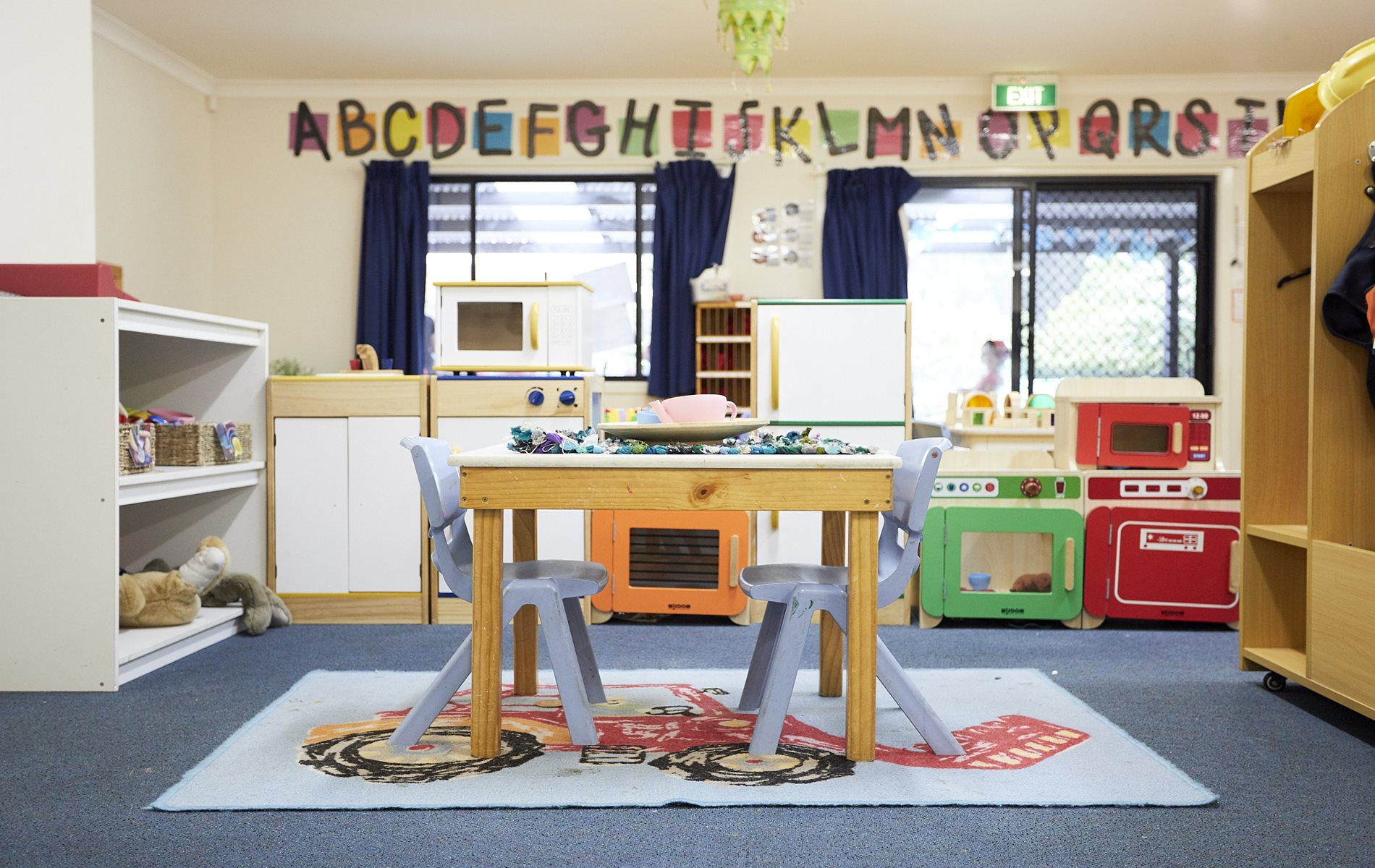Interior of child care classroom with play kitchenette area